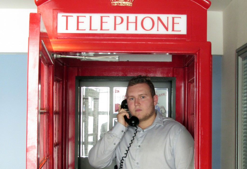 Kyle Maguire in a telephone red box