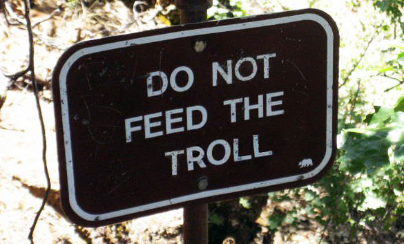 Black and White sign saying 'Do Not Feed The Troll'