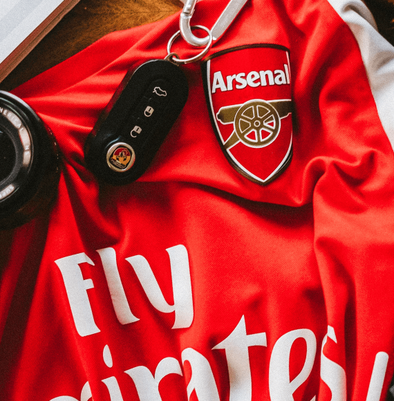 Arsenal Shirt and car key on a table