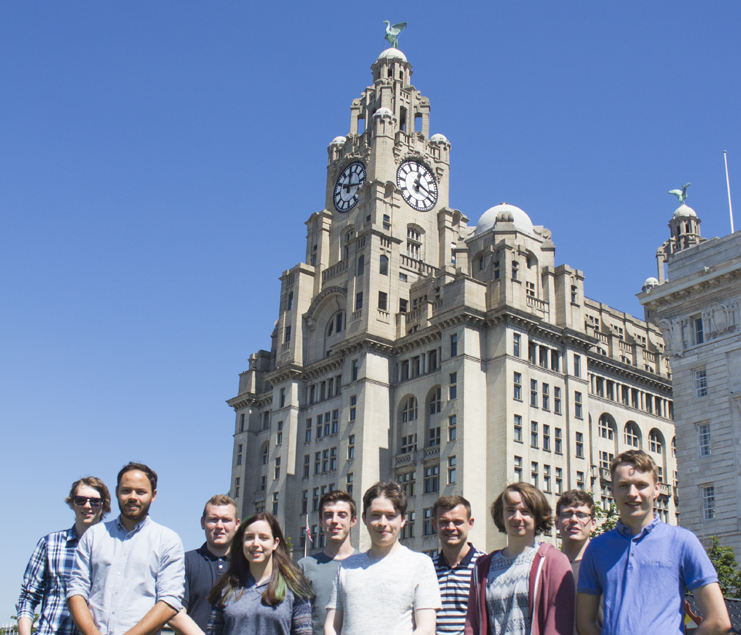 LJMU Student Web Developers standing in front of Liverpool Liver Building