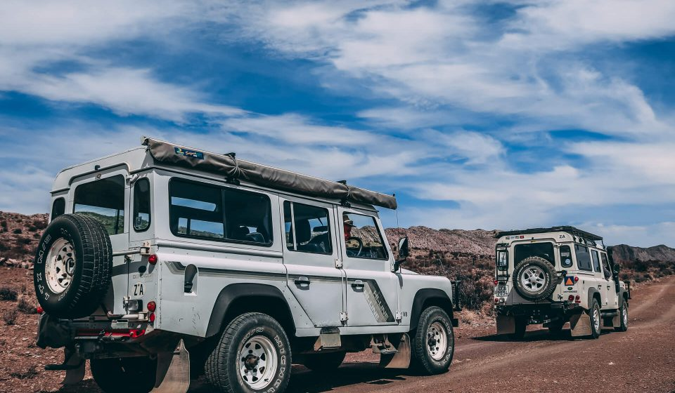 Two Land Rovers in the desert