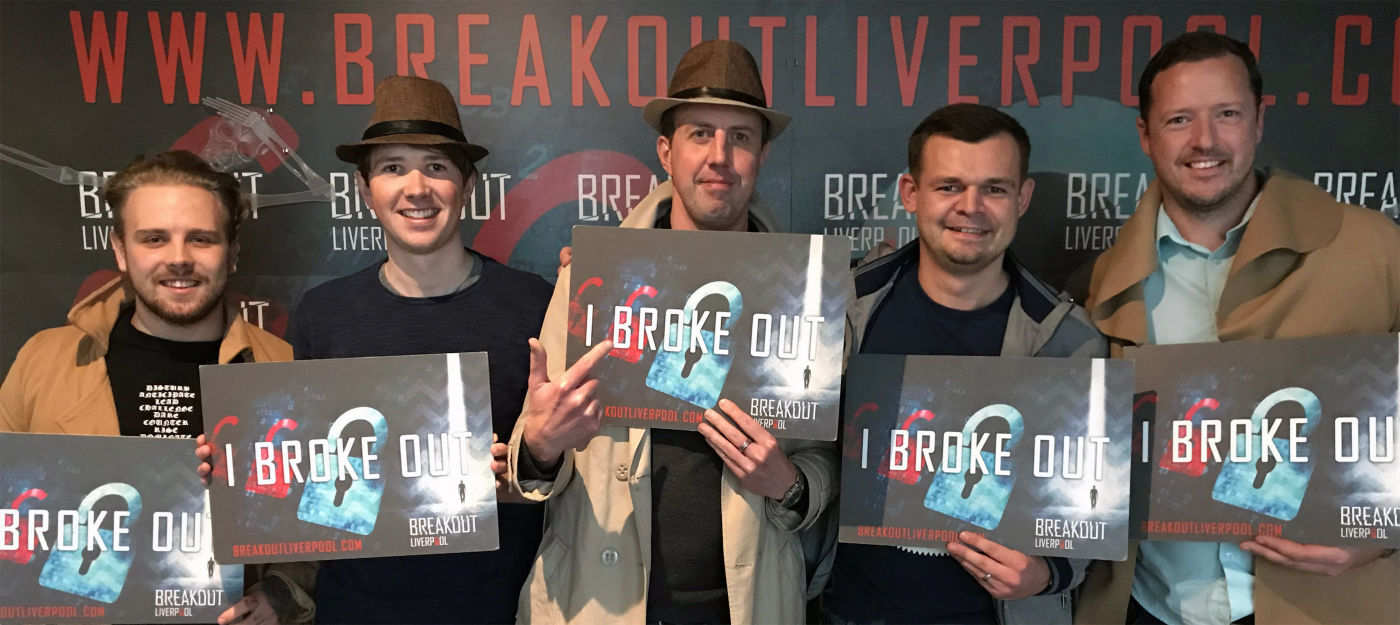 Webrevolve Team members celebrating breaking out of Breakout Liverpool